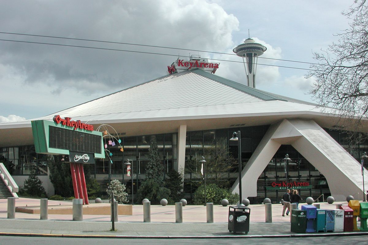 KeyArena on a cloudy day with the Space Needle in the background