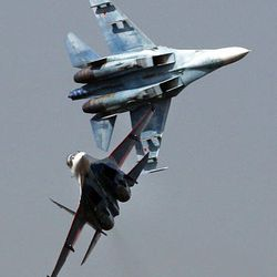 Sukhoi Su-27 fighter jets of the Russian air force elite aerobatic team Russkiye Vityazi (Russian Knights), the same types that collided Sunday, perform during an air show Saturday in Monino, some 24 miles east of Moscow.