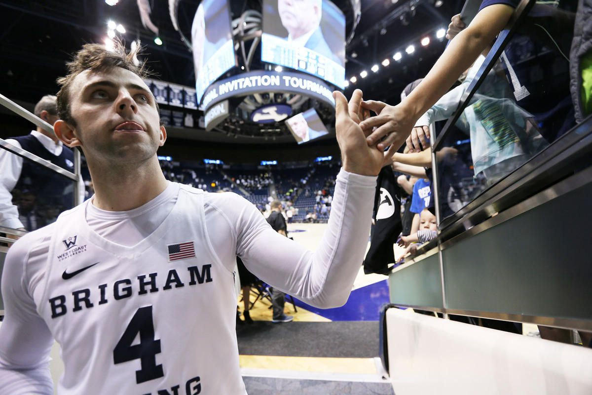 Brigham Young Cougars guard Nick Emery (4) gives high fives to fans after the game as BYU falls to the University of Texas at Arlington play in NIT basketball action at the Marriott Center in Provo Utah on Wednesday, March 15, 2017.