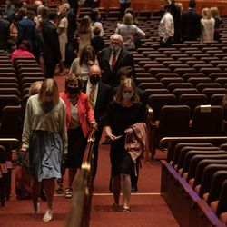 Attendees leave the Saturday evening session of the 191st Semiannual General Conference of The Church of Jesus Christ of Latter-day Saints at the Conference Center in Salt Lake City on Saturday, Oct. 2, 2021.