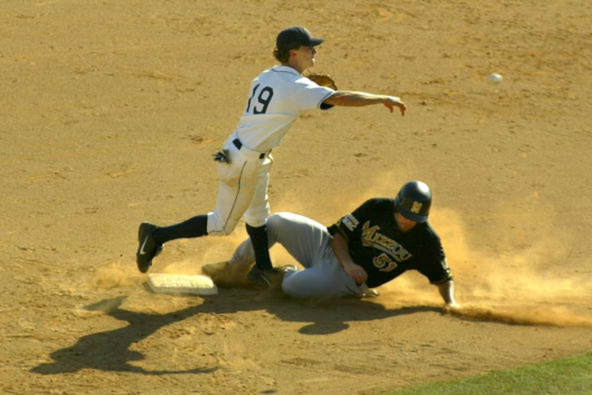 Jacob Priday attempts to break up a double play in the eighth inning of the NCAA college baseball regional game held on June 2, 2006, between Pepperdine and Missouri.