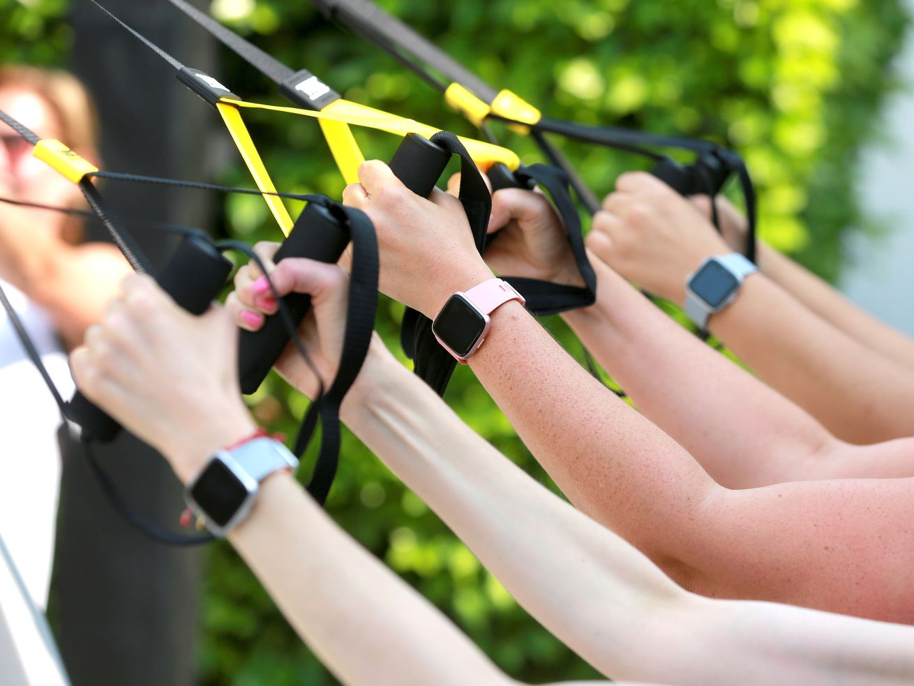 People exercising while wearing Fitbits.