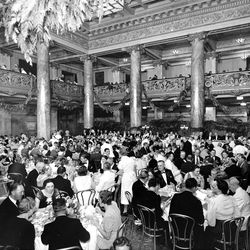 An undated photo of a banquet in the distinctive lobby of Hotel Utah.
