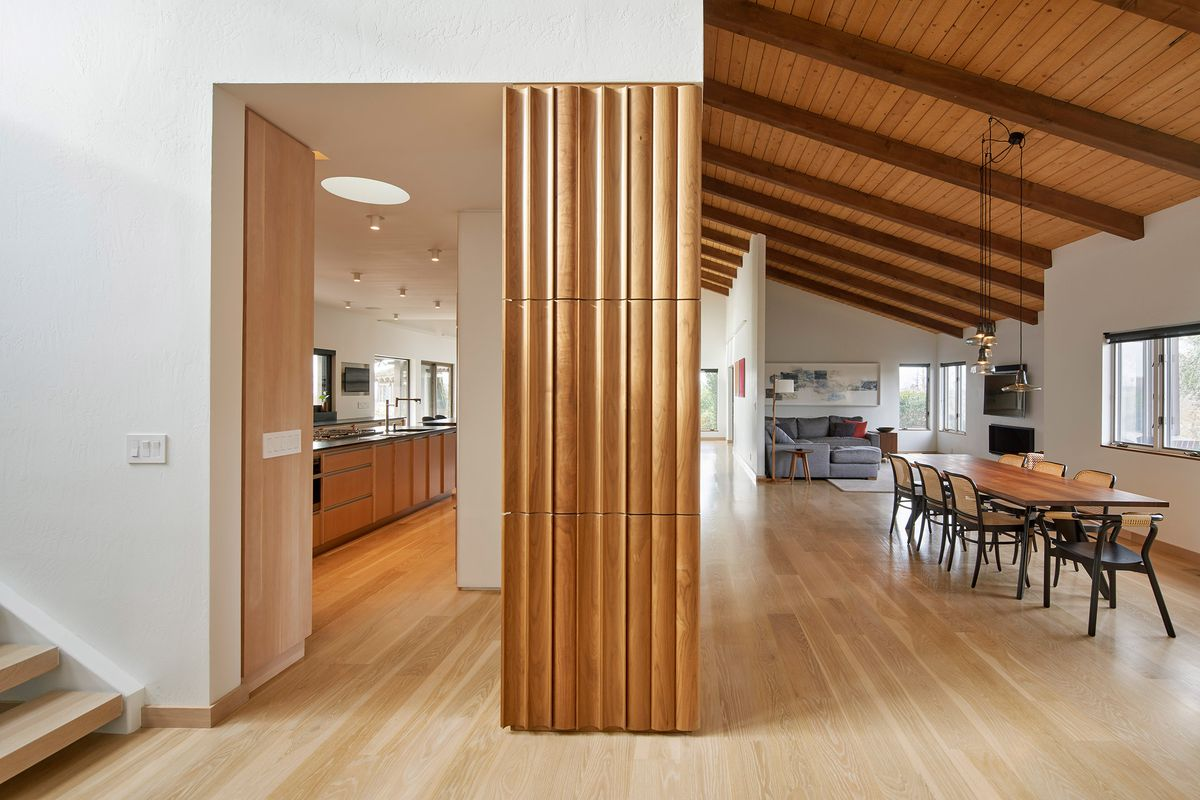 Interior of home with wood floors and white walls