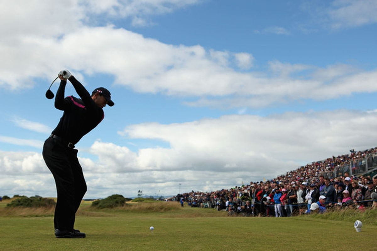 ST ANDREWS SCOTLAND - JULY 17:  Tiger Woods of the USA tees off on the fifth hole during the third round of the 139th Open Championship on the Old Course St Andrews on July 17 2010 in St Andrews Scotland.  (Photo by Richard Heathcote/Getty Images)