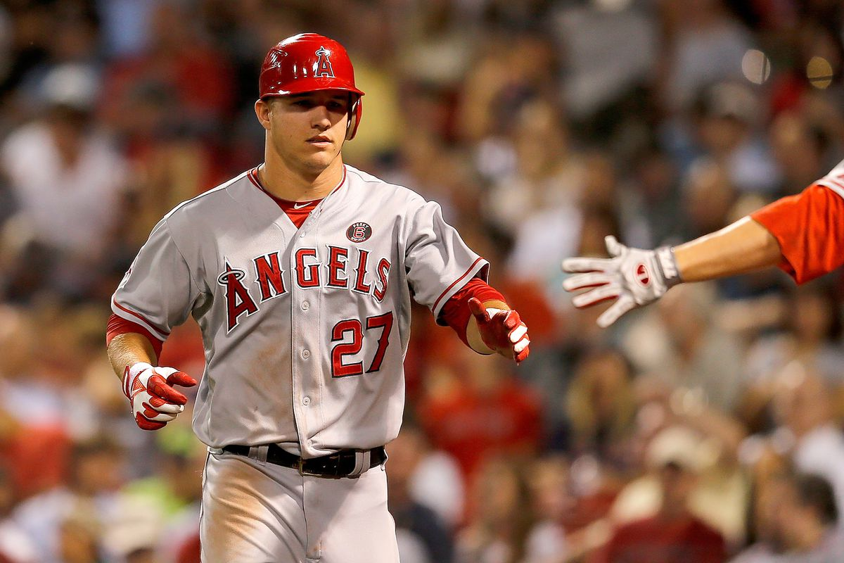 FOXBORO, MA - AUGUST 21:  Mike Trout #27 of the Los Angeles Angels scores a run in the third inning against the Boston Red Sox  at Fenway Park on August 21, 2012 in Boston, Massachusetts.  (Photo by Jim Rogash/Getty Images)