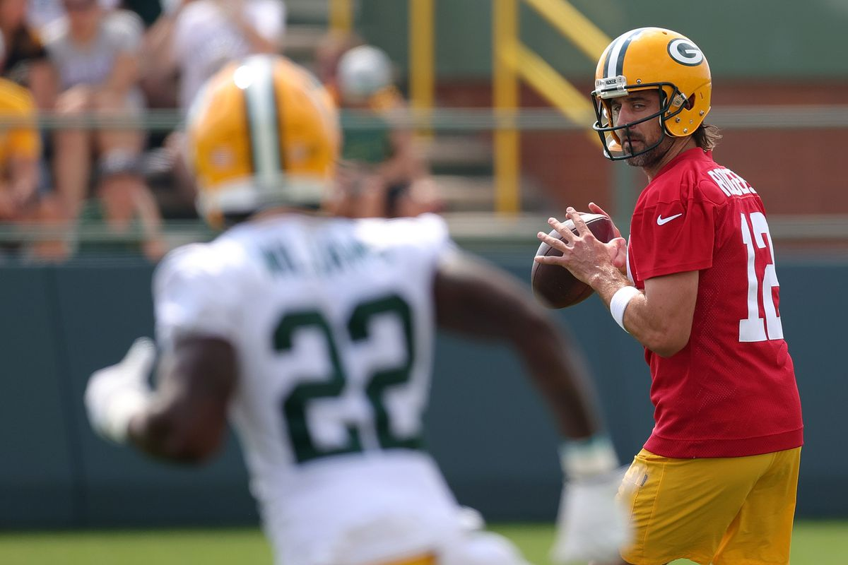 Aaron Rodgers #12 of the Green Bay Packers works out during training camp at Ray Nitschke Field on July 29, 2021 in Ashwaubenon, Wisconsin.