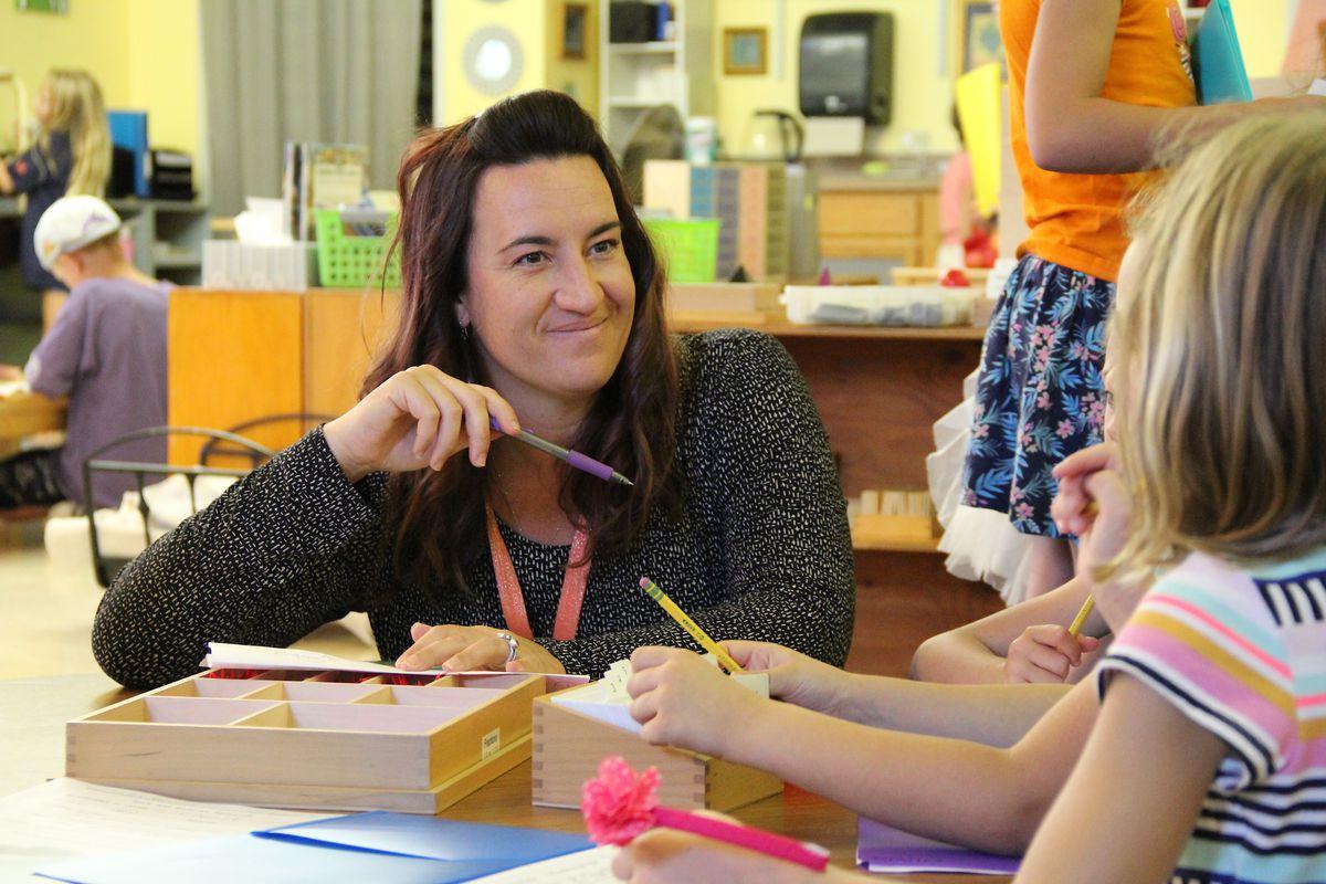 Megan Witucki, a teacher at Compass Montessori School in Wheat Ridge, works with students.