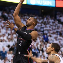 LA Clippers guard Chris Paul (3) shoots during the NBA playoffs game three between the Jazz and Clippers at Vivint SmartHome Arena in Salt Lake City on Friday, April 21, 2017.