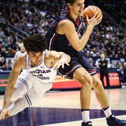 Brigham Young Cougars guard Elijah Bryant (3) loses the fight for a loose ball with Saint Mary's center Evan Fitzner (21) as the BYU Cougars take on the Saint Mary's Gaels in the Marriott Center in Provo on Saturday, Dec. 30, 2017.
