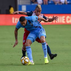 Michael Barrios (21) fouls New York City FC defender Alexander Callens (6) in the first half of MLS match.
