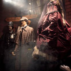 Sherlock Holmes: Coat and hat set, $149.99. Magnifying glass, $9. Monocle, $7.95. Men's vintage suit, $125. Victorian lady of the night: Corset, $148. Floor length skirt, $149.99. Black tulle cape, $119.50. Black metal rhinestone mask, $125. Spiderweb glo