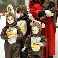 The Fonnesbeck family arrives at the costume contest dressed as monkeys. Families enjoyed a free afternoon of ice skating and games.