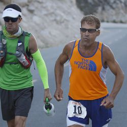 Dean Karnazes of Ross, California runs stiff with pain as he ascends the last few miles of Whitney Portal Road to the finish of the AdventurCORPS Badwater 135