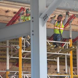 11:27 a.m. Workers removing the wood boards under the left-field bleachers -