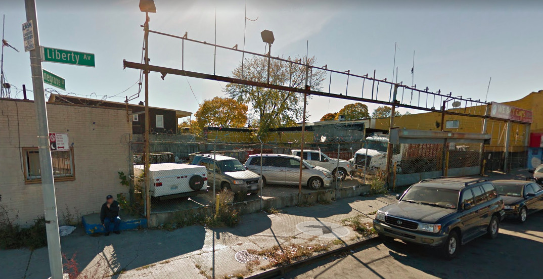 A parking lot with cars in Jamaica, Queens.