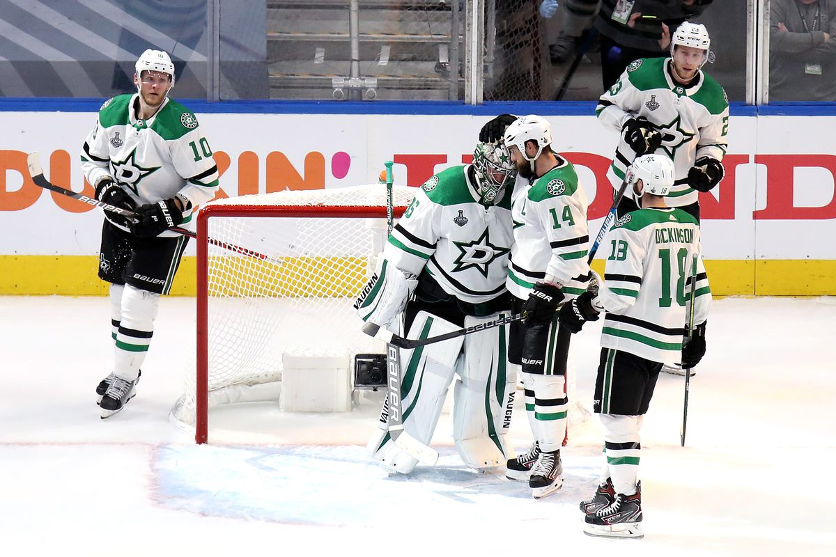 Anton Khudobin and Jamie Benn of the Dallas Stars celebrate their teams 4-1 victory against the Tampa Bay Lightning in Game One of the 2020 NHL Stanley Cup Final at Rogers Place on September 19, 2020 in Edmonton, Alberta, Canada.