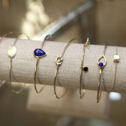 A few of Gordon's dainty bracelets, including the popular Love Knot Bangle in the middle.