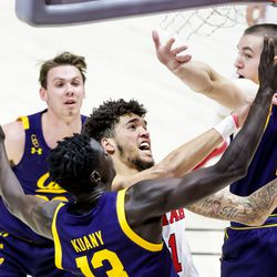 Utah Utes forward Timmy Allen (1) goes to the hoop against California Golden Bears forward Kuany Kuany (13) during the game at the Huntsman Center in Salt Lake City on Saturday, Jan. 16, 2021.