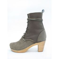 """<b>No. 6</b> 8"""" Lace Up Shearling Boot on a Mid Heel in string suede, <a href=""""http://no6store.com/no6-clog-boots/shearling/8-lace-up-shearling-boot-on-a-mid-heel.html"""">$430</a>"""