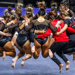 Utah's gymnasts huddle as Utah and UCLA compete in a gymnastics meet at the Huntsman Center in Salt Lake City on Friday, Feb. 19, 2021.