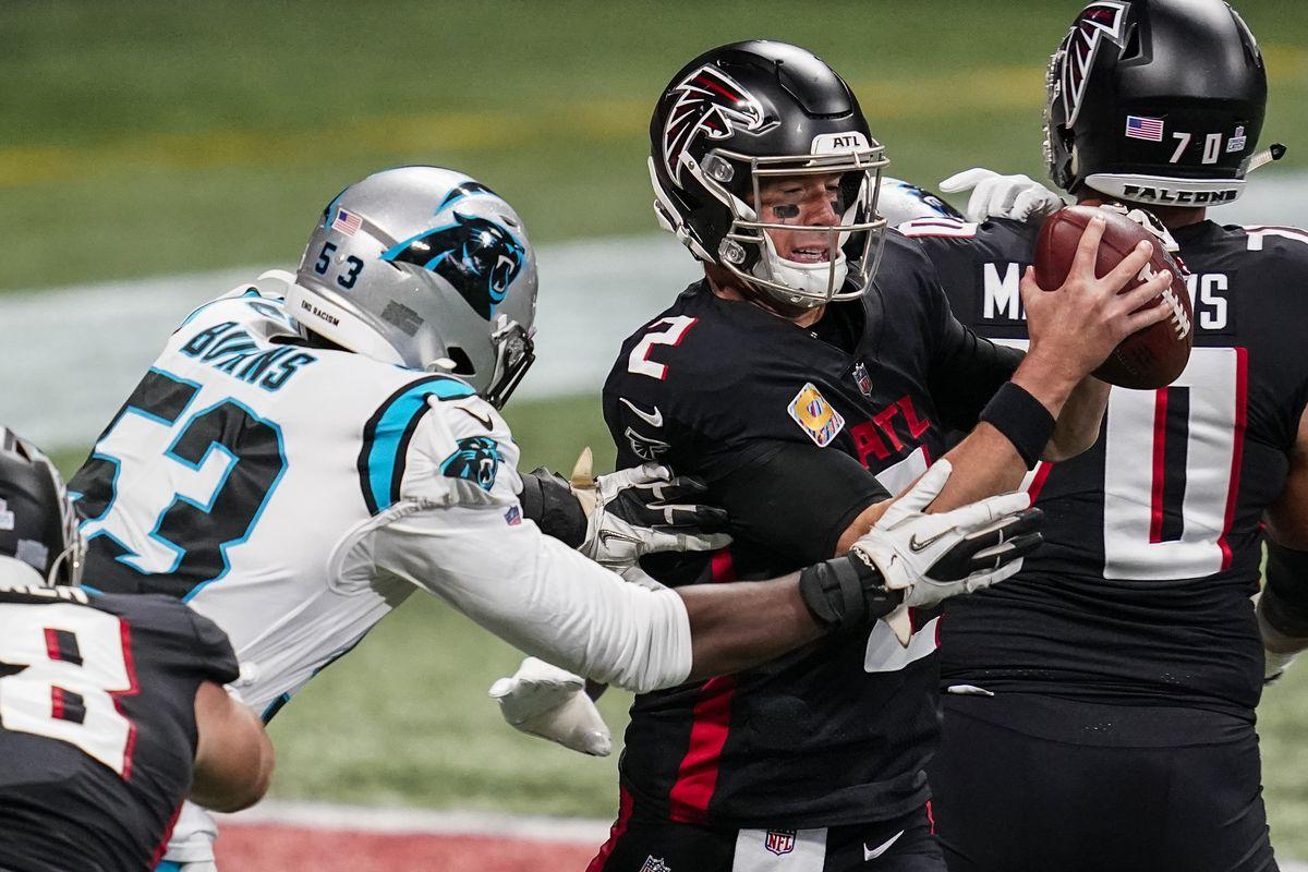Atlanta Falcons quarterback Matt Ryan (2) under pressure from Carolina Panthers defensive end Brian Burns (53) during the first half at Mercedes-Benz Stadium