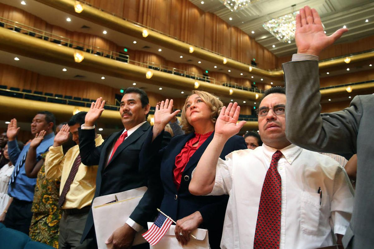 Nearly 400 people take the oath of citizenship at the Salt Lake County naturalization ceremony at Abravanel Hall in Salt Lake City. Unless immigrants are asked to assimilate, we will lose what binds us as a people and relegates the government to the backg