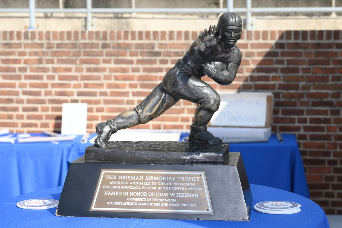 The Heisman trophy sits on a table during the game between the Sacred Heart Pioneers and the Penn Quakers on October 12, 2019 at Franklin Field in Philadelphia Pa.