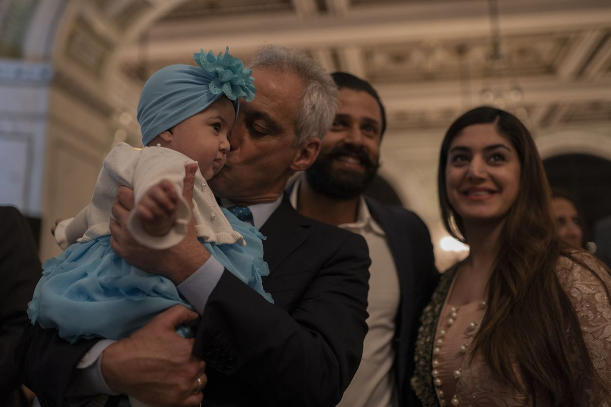 Mayor Rahm Emanuel kisses a baby as he meets people at the annual iftar meal at the Chicago Cultural Center on May 7, 2019.   Pat Nabong/For The Sun-Times