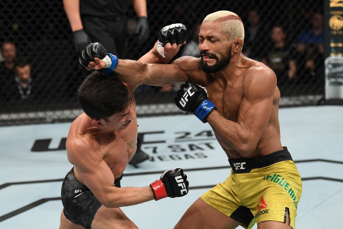 Joseph Benavidez punches Deiveson Figueiredo in their flyweight championship bout during the UFC Fight Night event at Chartway Arena on February 29, 2020 in Norfolk, Virginia.