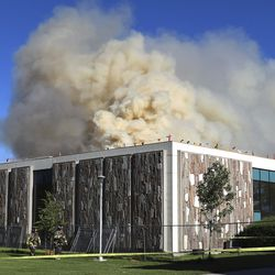 Thick smoke rises from the applied technology building, which is under construction, at the Salt Lake Community College campus at 4600 S. Redwood Road in Taylorsville on Monday, June 22, 2020.