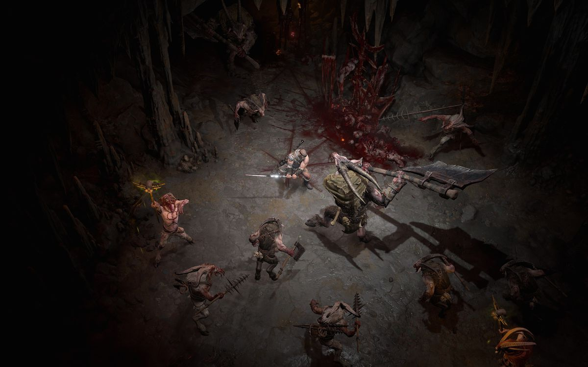 A barbarian fights demons in a cave in a screenshot from Diablo 4