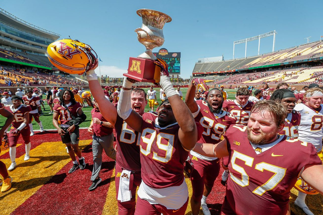 DeAngelo Carter hoists Goldy's Cup after the Gophers' spring football game