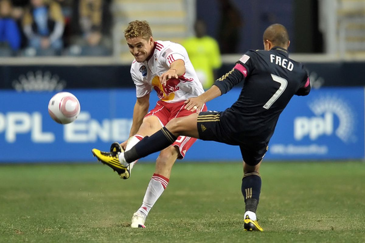 CHESTER PA- OCTOBER 16: Chris Albright (3) of the New York Red Bulls kicks the ball past Fred (7) of the Philadelphia Union at PPL Park on October 16 2010  in Chester Pennsylvania. (Photo by Drew Hallowell/Getty Images)