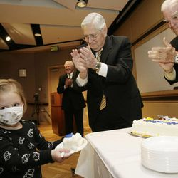 4 year old Cystic Fibrosis patient Kaylee Satterfield, Riverton, gets the first piece of cake from LDS Church Presiding Bishop H. David Burton and Spencer Eccles (R) at Primary Childrens Medical Center in Salt Lake City, Utah, Thursday, April 22, 2010. $4 million donation was given to Primary Children's to help construct a new $100 million-plus outpatient building across the street from the current hospital. $3 million from the Eccles Foundation and $1 million from the LDS Church. Jeffrey D. Allred, Deseret News