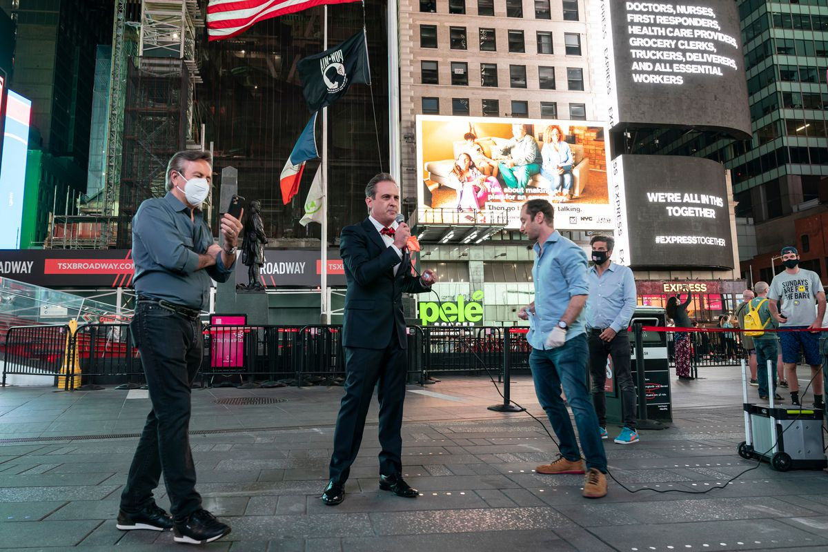 Lawyer John Houghtaling unveils an ad in Times Square to support small businesses getting insurance payments during the coronavirus shut down, May 27, 2020.