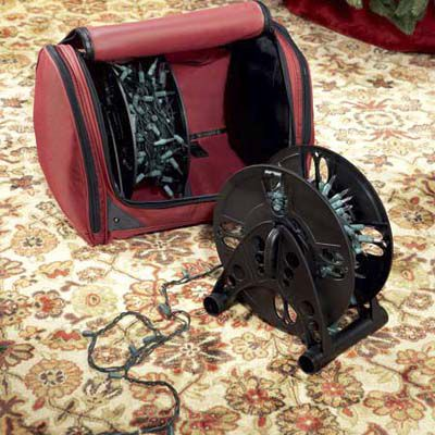 Two Christmas light storage reels and an accompanying bag to store them in.