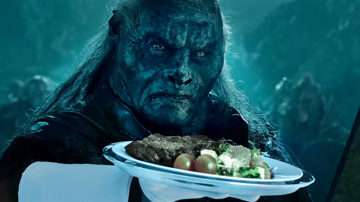 Orc waiter presenting a steak dinner