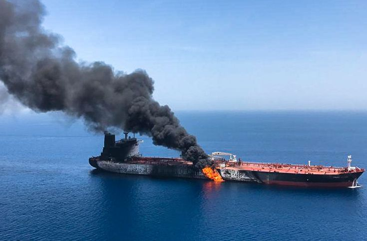 Fire and smoke billowing from the Norwegian-owned Front Altair oil tanker attacked in the waters of the Gulf of Oman on June 13, 2019. The US blames Iran for the bombing.