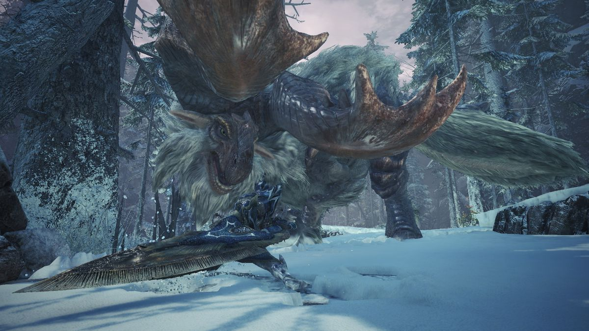 A Banbaro in a snowy field glowers down at a hunter in Monster Hunter World: Iceborne.