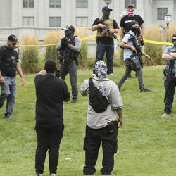 Insurgence USA protesters, front, clash with Utah Citizens' Alarm members as they rally at the Capitol in Salt Lake City on Wednesday, July 22, 2020.