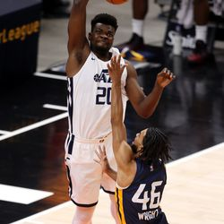 Utah Jazz White team center Udoka Azubuike (20) goes up and blocks Utah Jazz Blue team guard Isaiah Wright (46) as the Utah Jazz Blue and White teams play in summer league action at Vivint Smart Home Arena in Salt Lake City on Friday, Aug. 6, 2021.