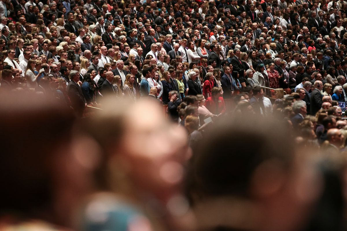 Conferencegoers rise and sing with the choir during the Saturday morning session of the 188th Annual General Conference of the LDS Church at the Conference Center in Salt Lake City on March 31, 2018.