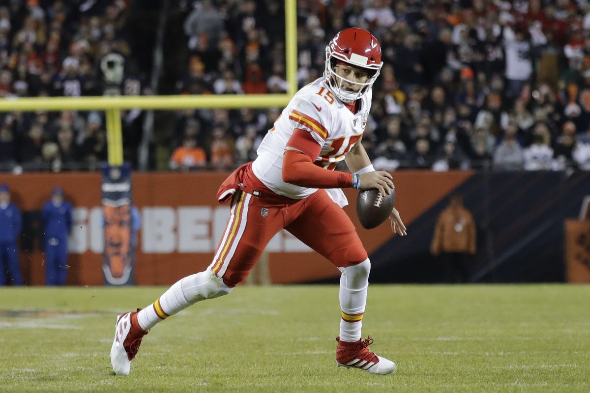 Kansas City Chiefs quarterback Patrick Mahomes  runs for a 12-yard touchdown against the Bears in the first half of Sunday's game at Soldier Field.