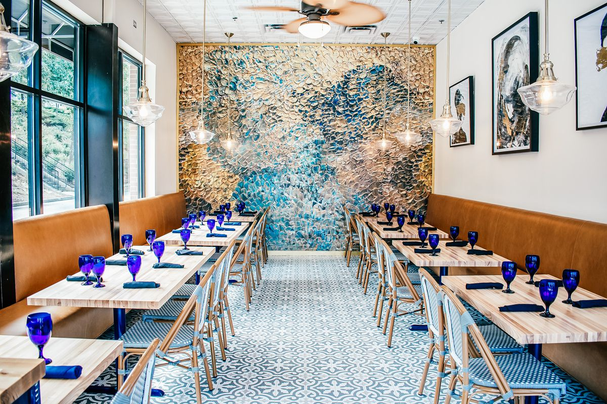 Inside the dining room at 285 Colonial Kitchen with set tables