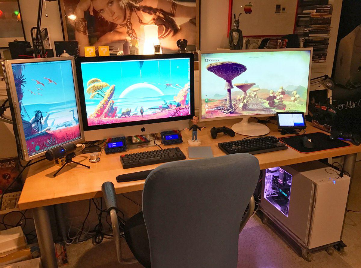 three monitors on a desk