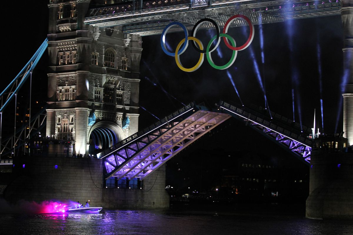 LONDON, ENGLAND - JULY 27:  The Olympic Torch rides on a boat under Tower Bridge during the opening ceremony of the London 2012 Olympic Games on July 27, 2012 in London, England.  (Photo by Streeter Lecka/Getty Images)