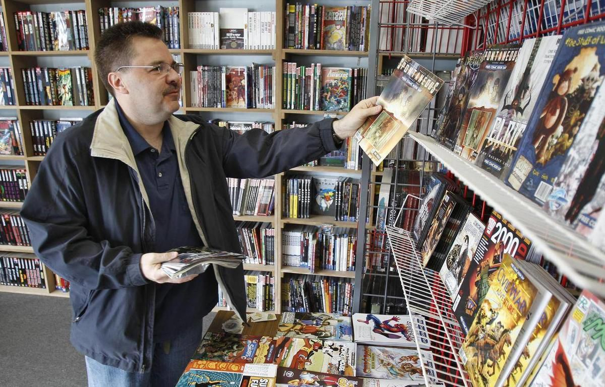 Ron Bufalini, from Ambridge, Pa., looks over the free comic books available at the New Dimensions Comics store on Free Comic Book Day, Saturday, May 7, 2011 in Cranberry, Pa.