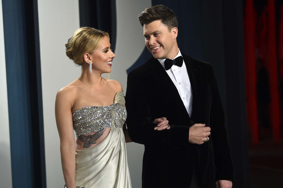 In this Feb. 9, 2020 file photo, Scarlett Johansson and Colin Jost arrive at the Vanity Fair Oscar Party in Beverly Hills, California.