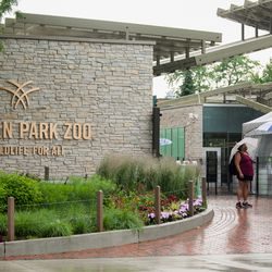 Visitors stand outside Lincoln Park Zoo on the first day of Illinois' Phase 4 reopening, Friday afternoon, June 26, 2020.